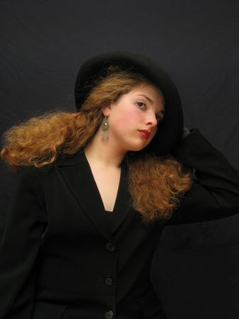 young pretty lady in dark hat