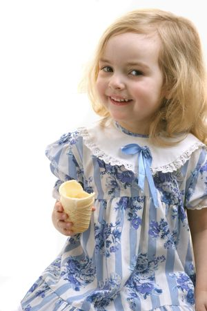 little girl eating ice-cream smlling