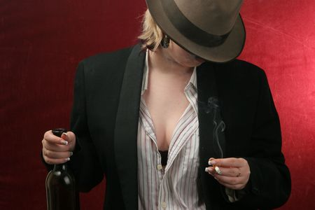 drunk woman with wine bottle and cigarette photo