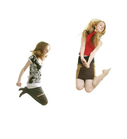 tenager: two slim girls jumping isolated on withe Stock Photo