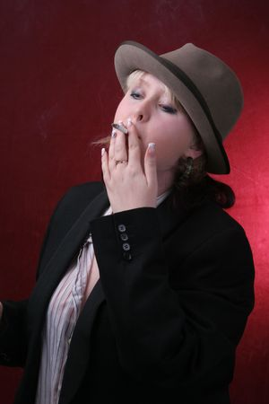 smocking: young woman in gray hat  smocking cigarette