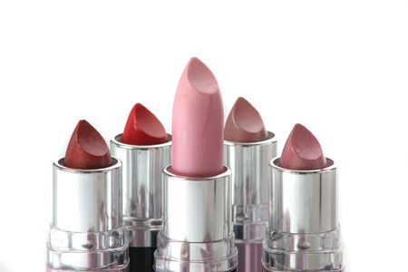 five different lipstick pink red and other