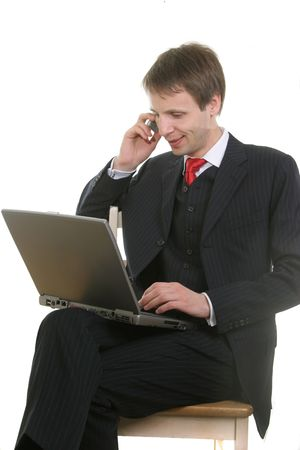 businessman with cell phone and laptop PC isolated on withe