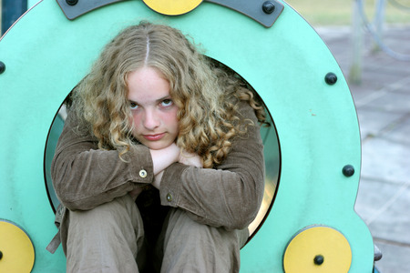 tenager: pretty young tenager at the children play ground Stock Photo