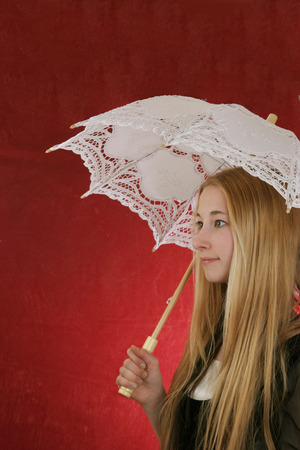 dressups: pretty young ladywith  old time white sun umbrella  Stock Photo