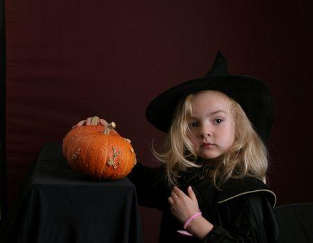 wizard hat: toddler with pumpkin in wizard hat