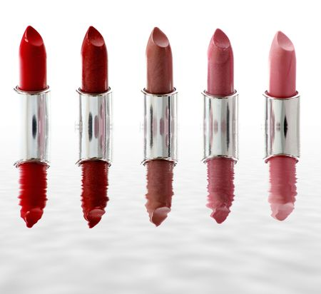 five different lipstick with reflection photo