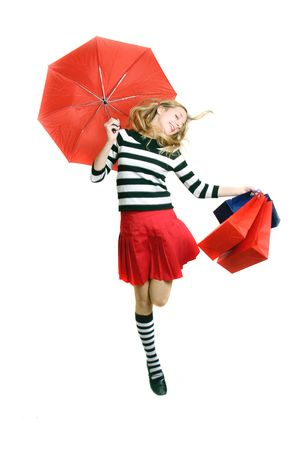 pretty teenager girl with umbrella and shopping bags photo