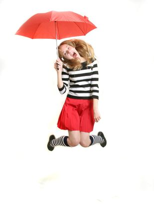 happy teenager girls  with red umbrella  jumping - over white