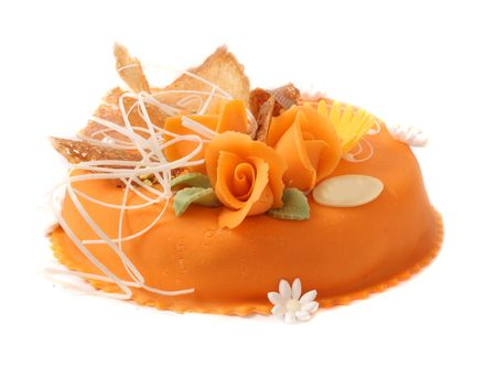 orange cake with orange rooses over white Stock Photo