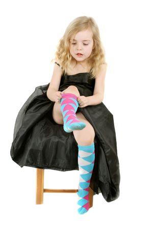 girl in evening dress vearing socks - over white photo