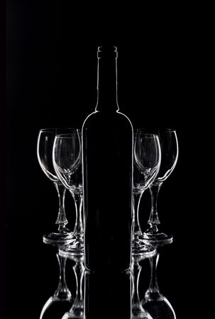 Wine  glasses and bottle contour over black Stock Photo