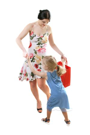 beautiful young woman with shopping bag dancing with her daughter photo