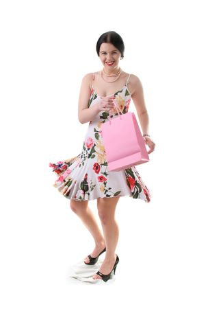 beautiful young woman with shopping bag jumping photo