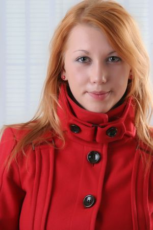 red head: red head student  in read coat with window shadow