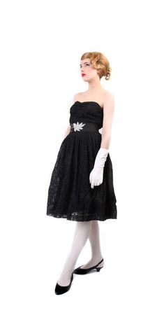 xx century: pretty young girl with long  hair over white   l dress  in  style of the 50thies  XX century