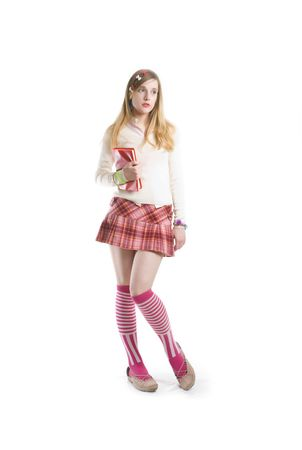 Sweet teenager school girl in pink mini skirt with red book