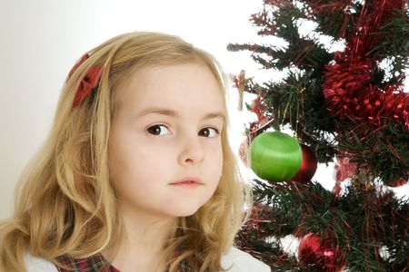 Very pretty girl and a christmas tree Stock Photo - 5180227
