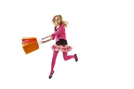 hurry it's a sale time - girl with shopping bag runing or jumping. Isolated over white Standard-Bild