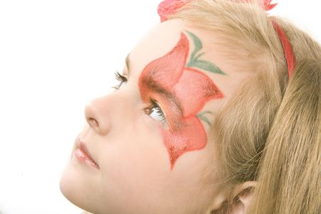 little girl with paynted flower on her face  - studio shot  photo