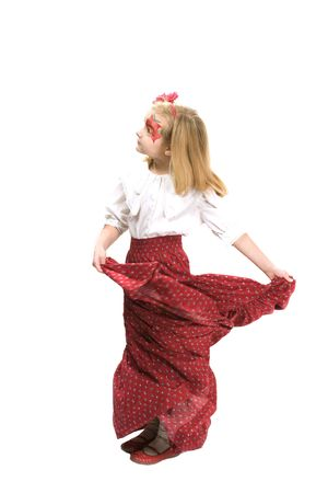 little girl with paynted flower on her face  - dancing flamenco studio shot  photo