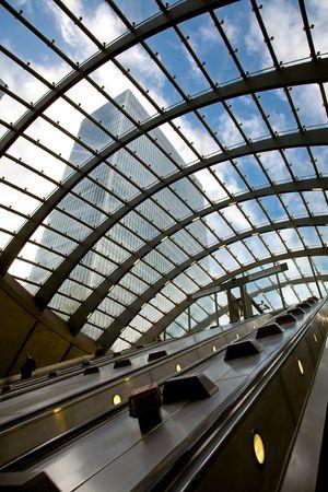 wharf: escalator in a new modern underground station - Canary Wharf Stock Photo