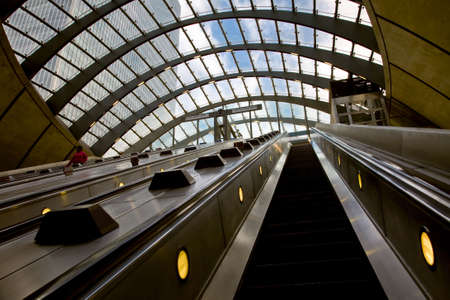 escalator in a new modern underground station - Canary Wharf Stock Photo