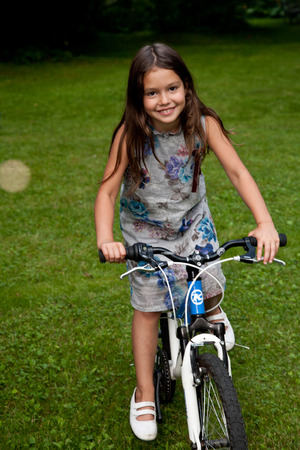 7 year old girl: Eight years old girl portrait on the fresh air Stock Photo
