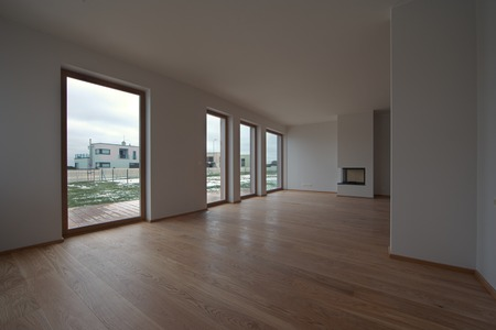 fire place: empty bright room with fore windows and fire place