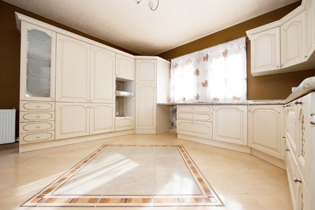 tiled stove: white and brown kitchen with white windows Stock Photo