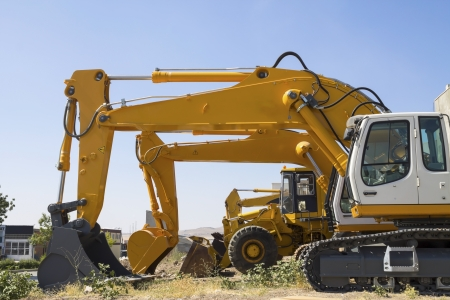 Excavator machines and bulldozer photo