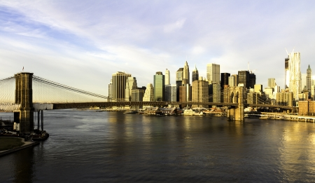 manhattan bridge: Lower Manhattan in the background of Brooklyn Bridge in a sunny morning, New York, United States Stock Photo