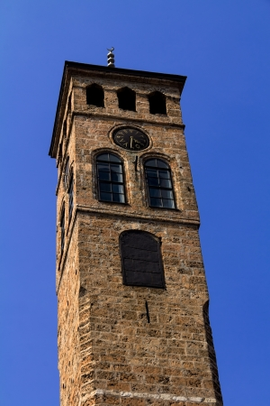 saraybosna: Watch tower in Sarajevo, the capital city of Bosnia and Herzegovina, with blue sky.