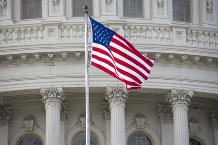 us capitol: US flag on Capitol Building Dome Background, Washington, DC, USA. Stock Photo