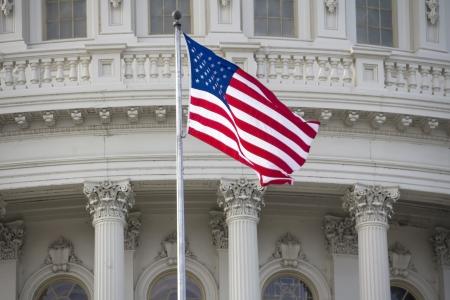 politics: US flag on Capitol Building Dome Background, Washington, DC, USA. Stock Photo
