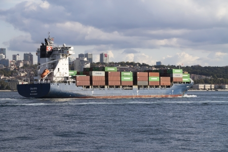 reg: ISTANBUL - AUG 31: Container ship, Calisto passing through Bosphorus on August 31, 2013 in Istanbul, Turkey. The 2005 built,15,487gt.cont ainer ship CALISTO reg. Monrovia.