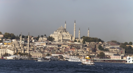 suleyman: ISTANBUL - AUG 31: Eminonu ferry pier with Suleymaniye Mosque in background on August 31, 2013 in Istanbul, Turkey.