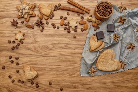 Background with homemade cakes, fragrant cookies. Cookies in the form of hearts, stars, coffee beans, spices, almonds close-up. menu concept, Home baking. Full size, cookiespeanuts Stock Photo