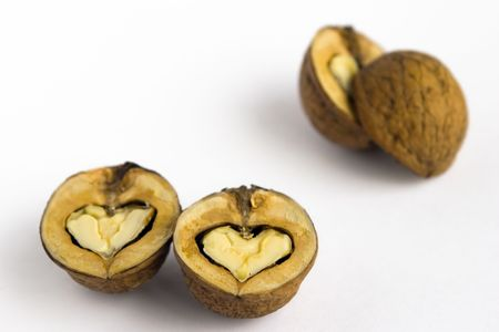 The split walnuts - as hearts. photo
