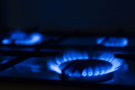 Torch of a gas cooker on kitchen photo