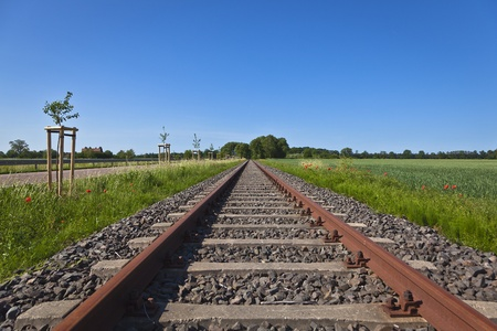 single rail track on the open road