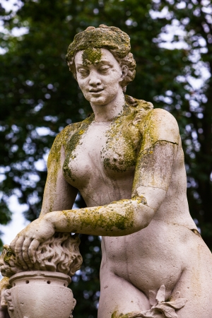 Baroque statue covered with lichens