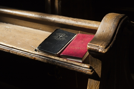 songbook: ancient prayer bench with Gesangbuechern