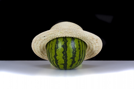 Melon with straw hat Stock Photo