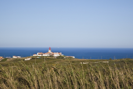 savety: lighthouse cabo da roca in Portugal, the westernmost point of europe - lighthouse cabo da roca the most western point in europe Stock Photo