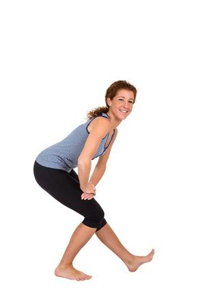 elongacion: Alargamiento de los músculos flexores de la pierna Foto de archivo