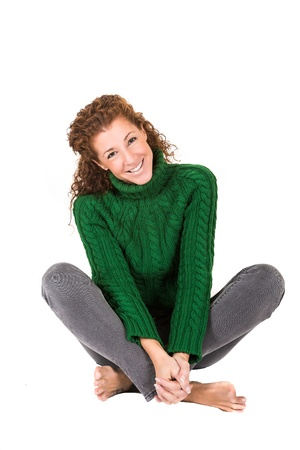 nem: red-haired young woman in green sweater knitting NEM