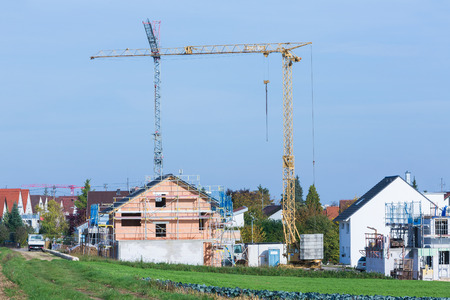 scaffolds: houses with scaffolds and cranes Stock Photo