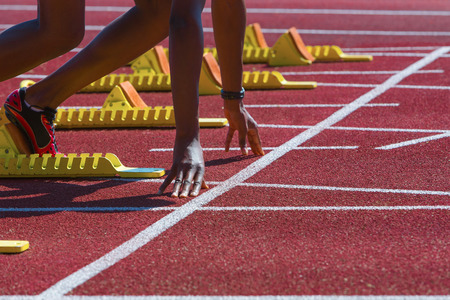 Detail of a runner at start position with starting line