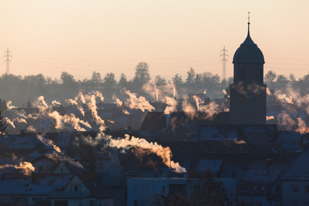 smoking chimneys and roofs Stockfoto